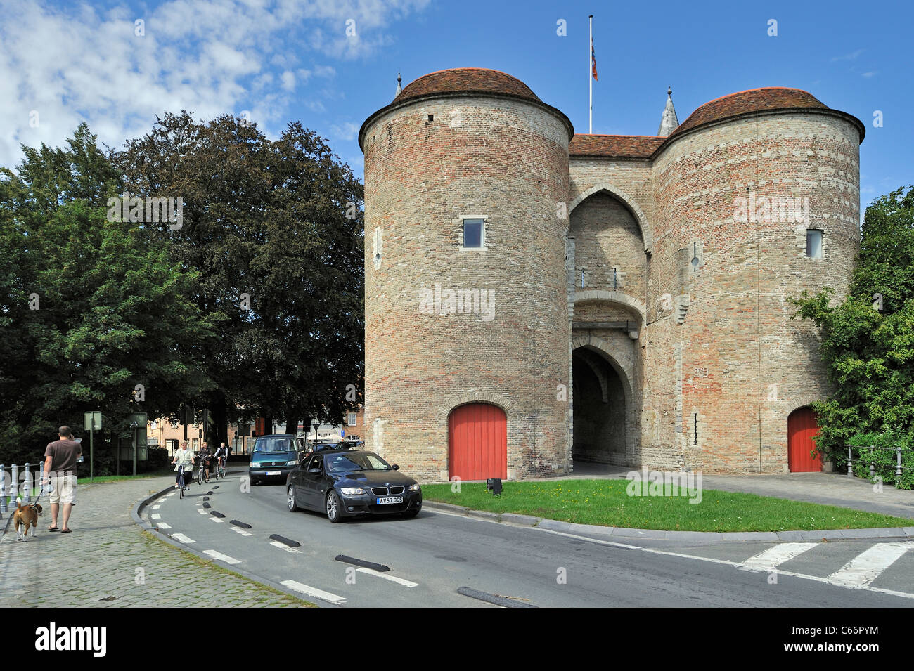 Traffic leaving town and the city gate Gentpoort / Ghent Gate in Bruges, Belgium Stock Photo