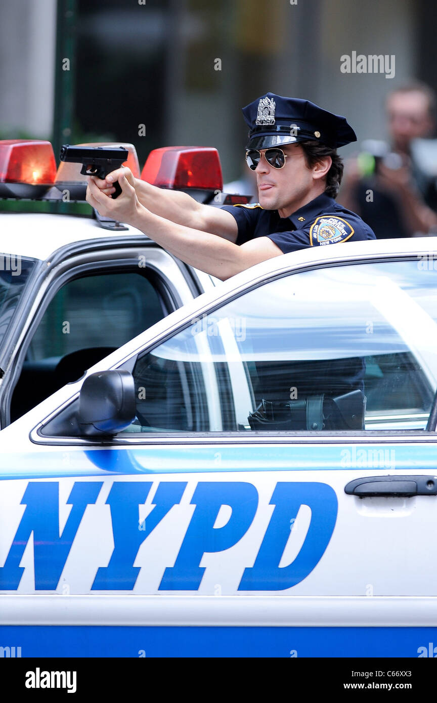 Matt Bomer, films a scene at the 'White Collar' film set in Midtown Manhattan out and about for CELEBRITY - Stock Image