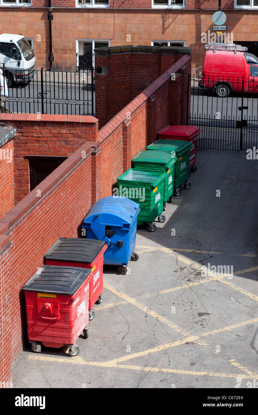 Large Biffa wheelie bins for commercial waste at the back of a premises in a city centre. Stock Photo