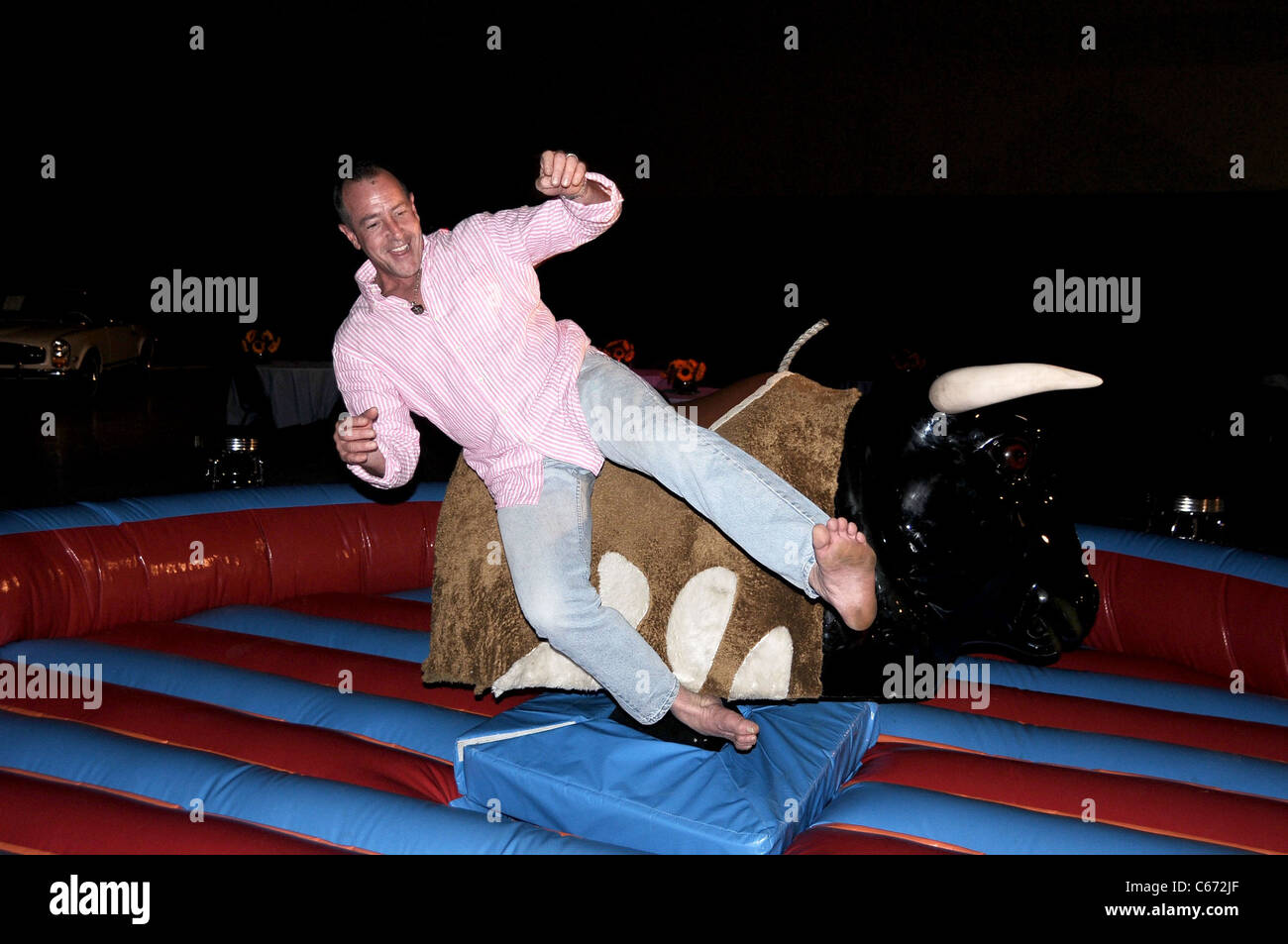 EXCLUSIVE!!! Michael Lohan, riding mechanical bull in attendance for Models Hotel Carnival Benefiting Fashion Delivers, - Stock Image