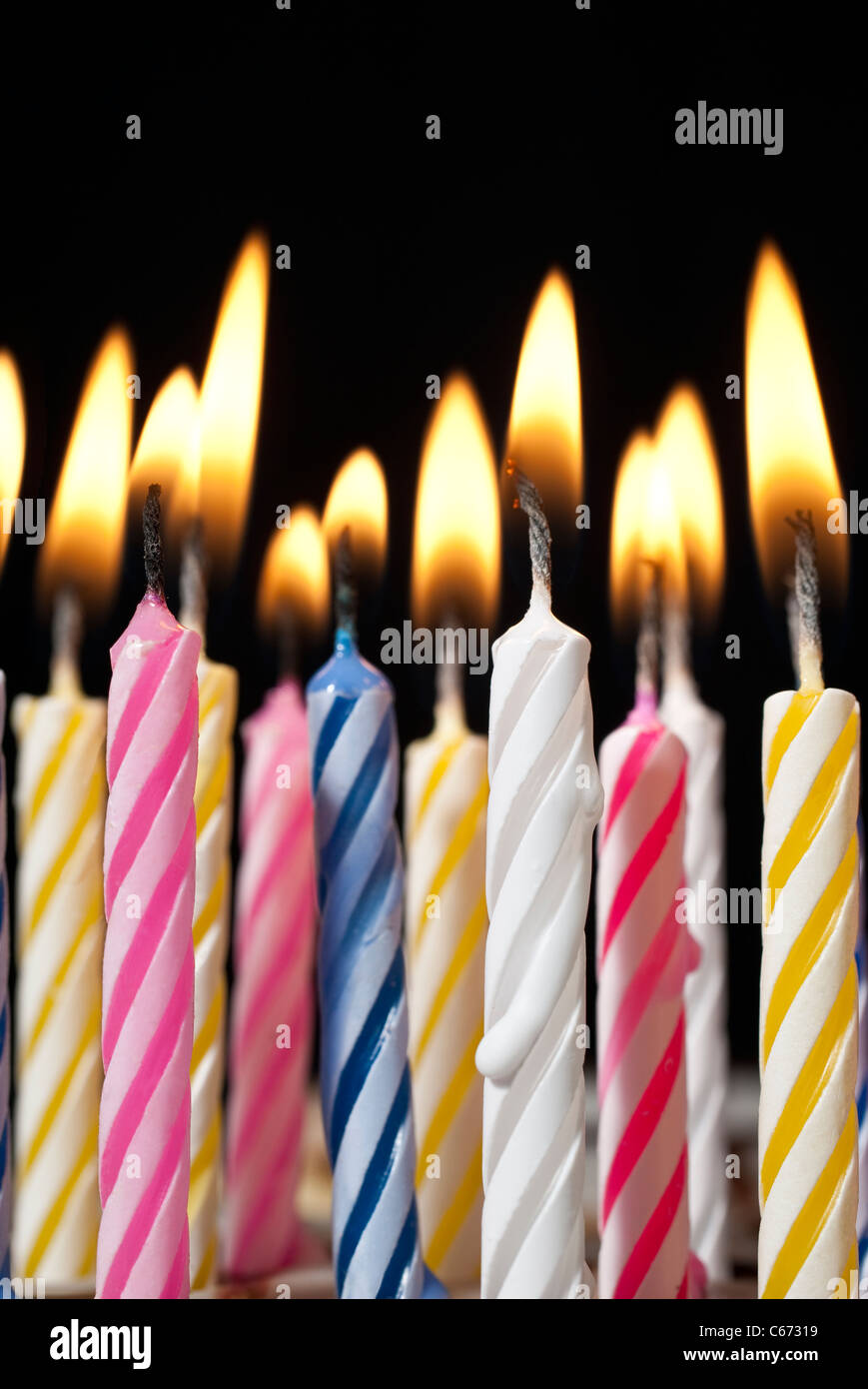 Surreal Image Close Up Of Multiple Candy Colored Lit Birthday Candles