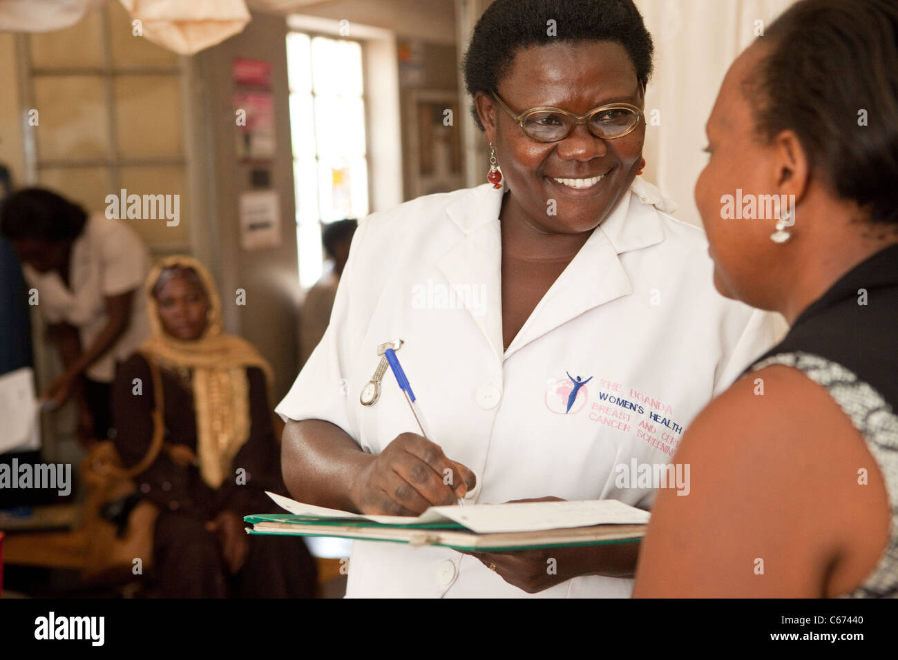 A nurse consults with a patient at a clinic in Kampala, Uganda, East Africa. Stock Photo