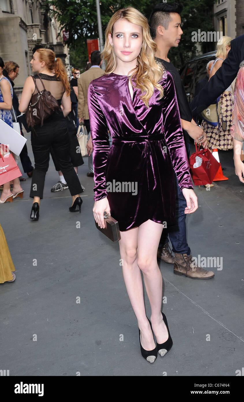 8d7dd5e18c8 Emma Roberts (wearing a Salvatore Ferragamo dress) in attendance for ...