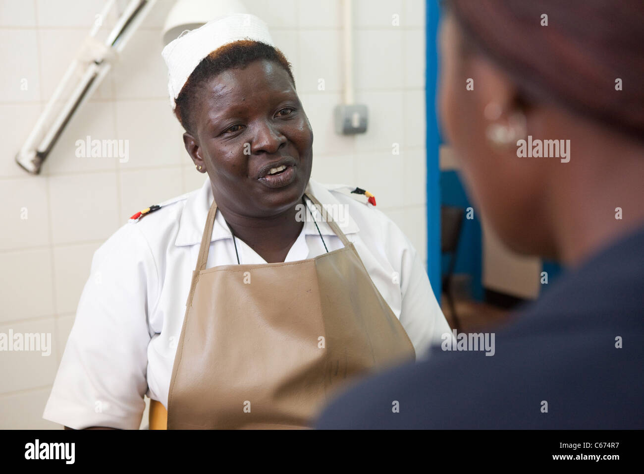 A nurse consults with a patient at Mbale Regional Referral Hospital in Mbale, eastern Uganda. Stock Photo