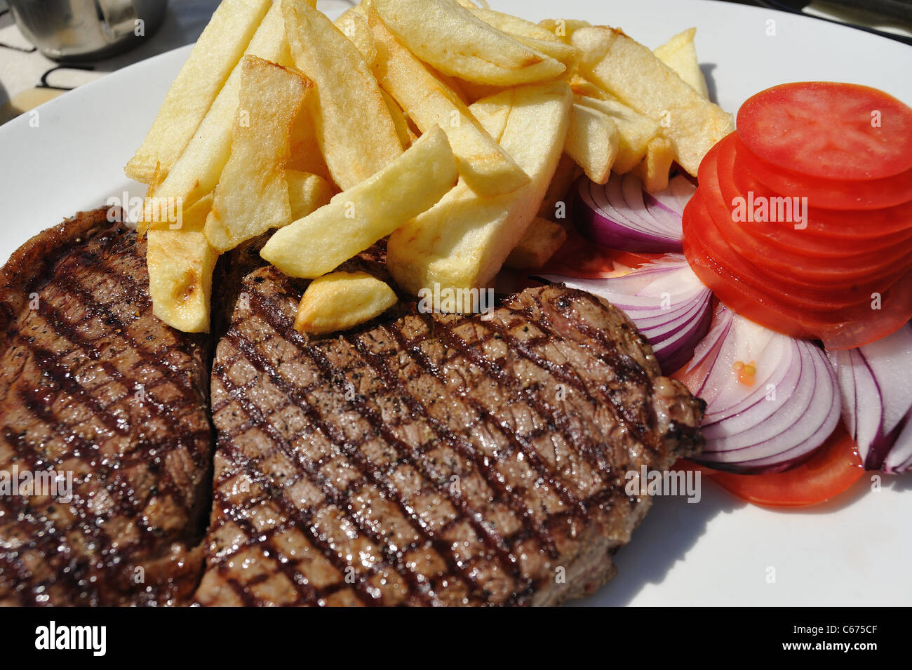 Steak chips onions and tomatoes - Stock Image