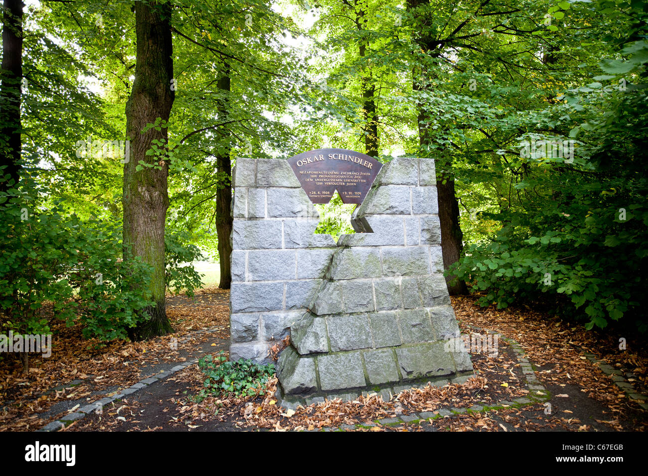 Monument to Oskar Schindler over the road vis-a-vis of his birthplace in his native town. - Stock Image