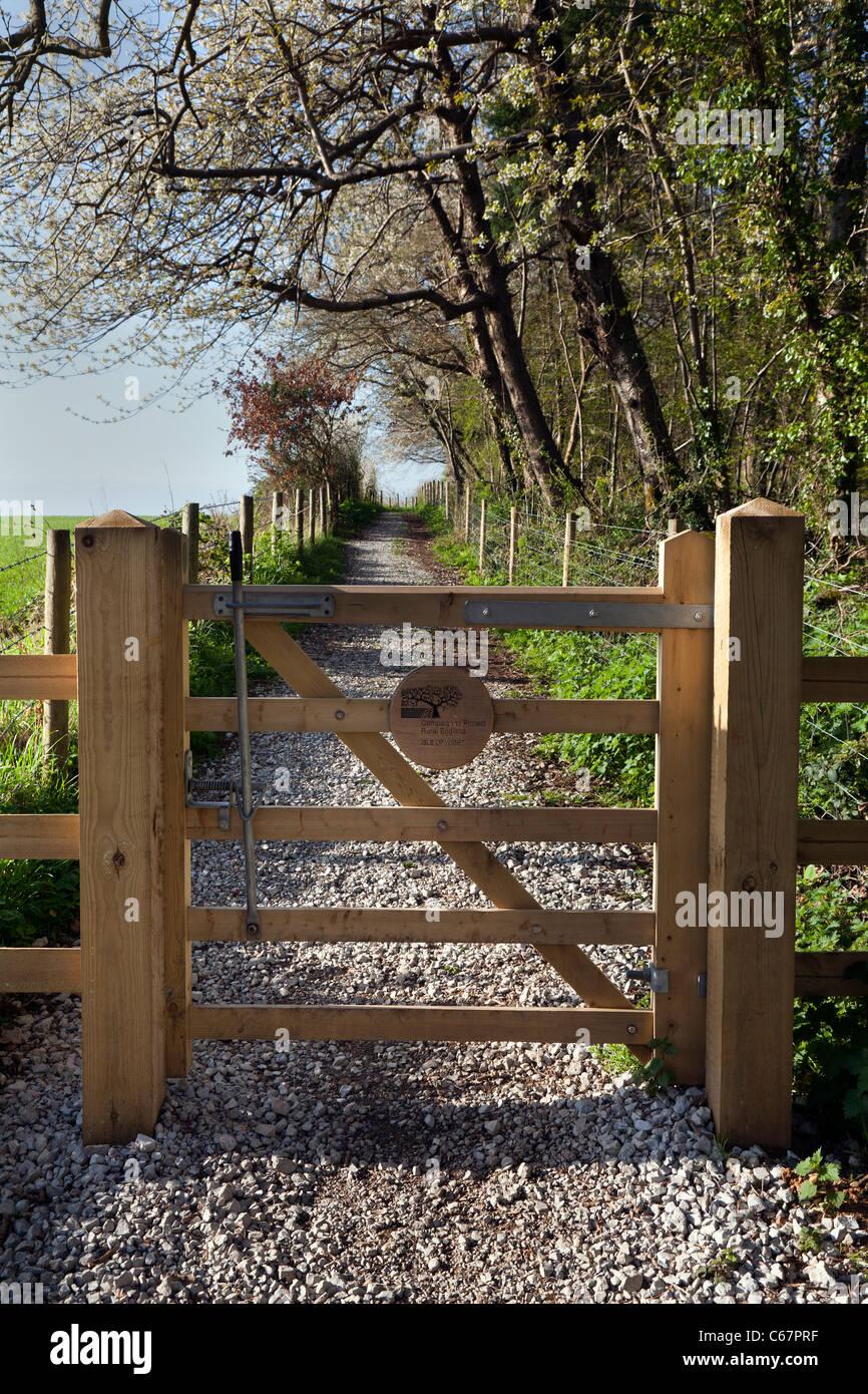 Public footpath bridleway new wooden oak gate path fence track spring fresh blossom IOW - Stock Image