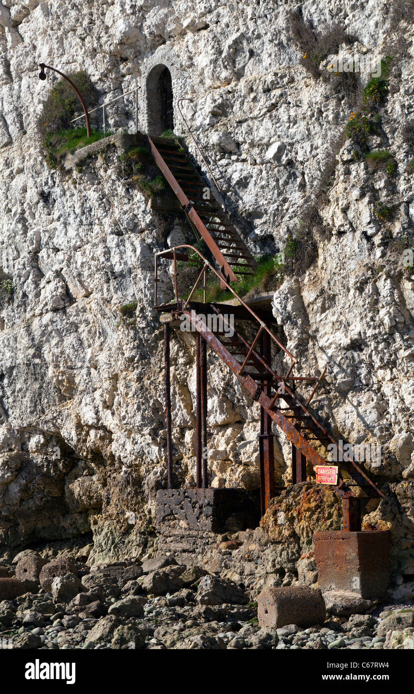 Old rusty iron stairs steps Freshwater cliff IOW Isle of Wight dangerous unstable steep chalk cliff-face entrance Stock Photo