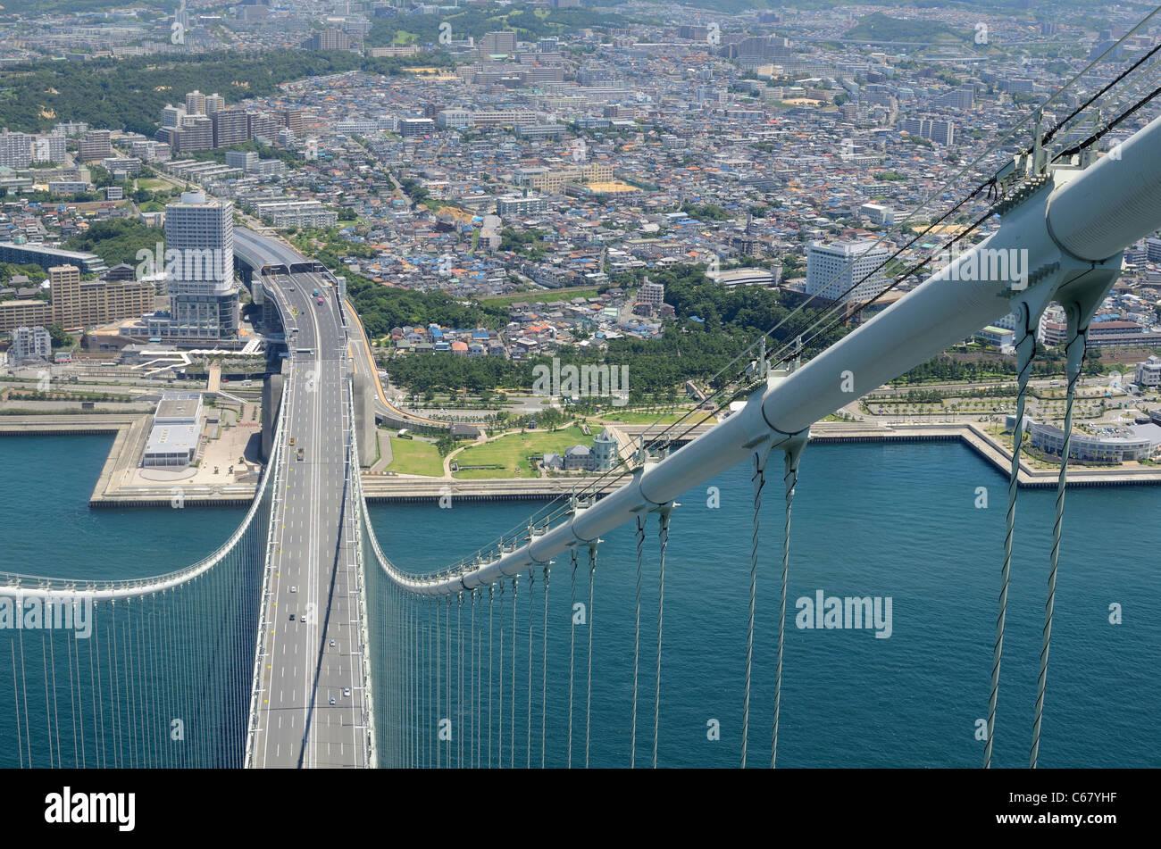 Cable of Akashi Kaikyo Bridge and Kobe City, Japan. - Stock Image