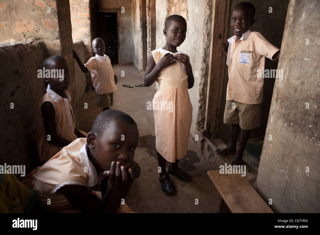 School students sit in the hallway of a school in Amuria, Uganda, East Africa. - Stock Image