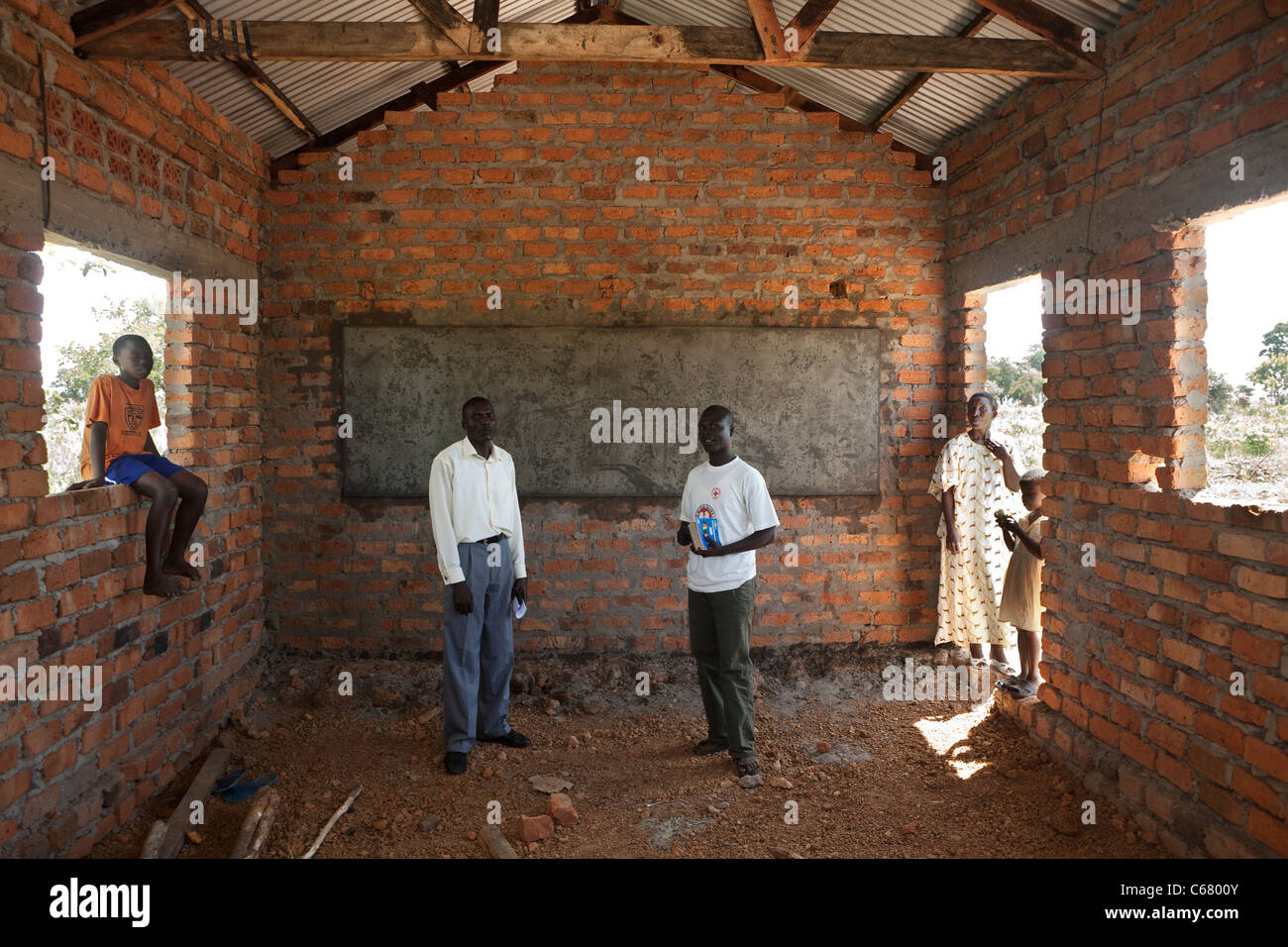 People stand in a vacant school room in Amuria, Uganda, East Africa. - Stock Image