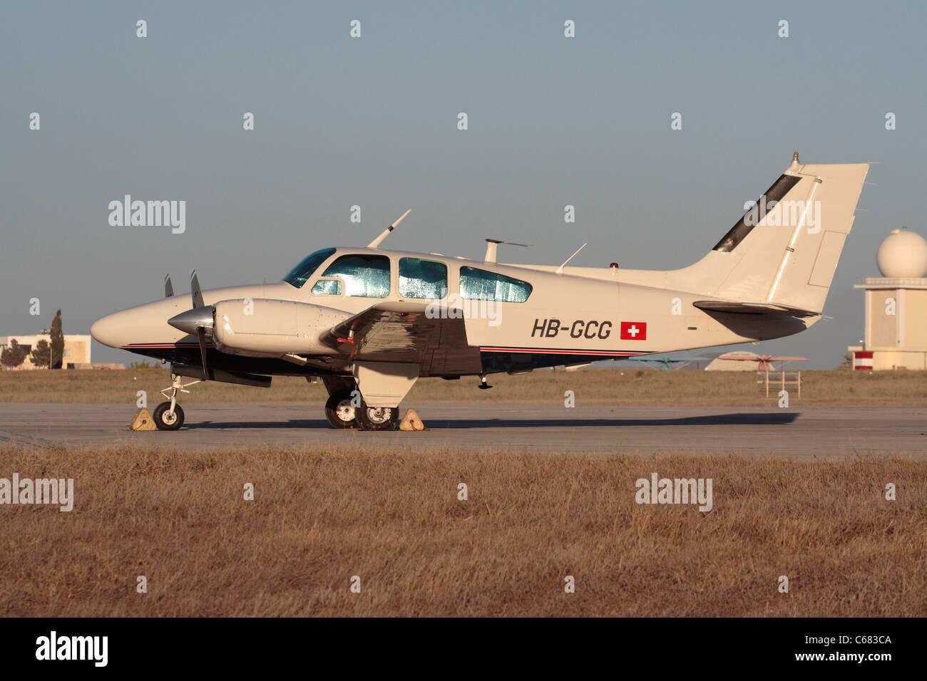 Parked Beechcraft Baron 55 light aircraft Stock Photo