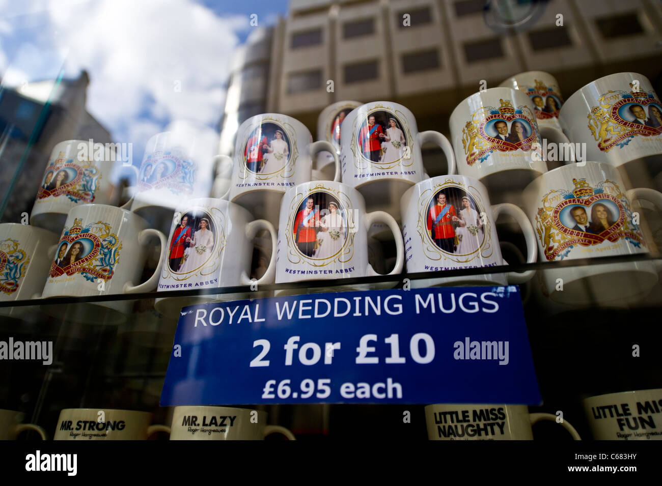 Royal wedding souvenirs still for sale at discount in a London shop window months after the wedding. - Stock Image