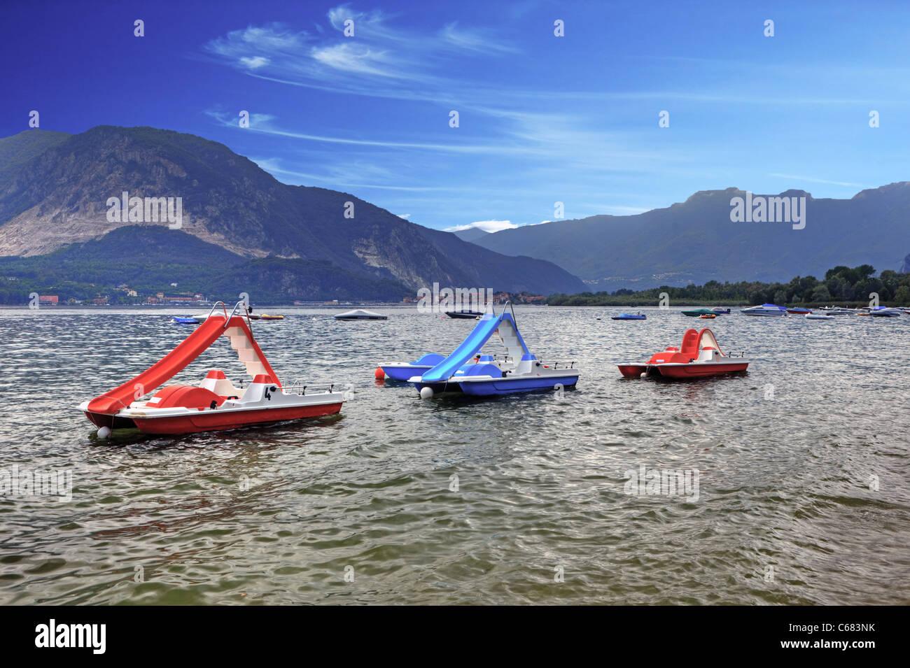 three pedal boats on Lake Maggiore - Stock Image