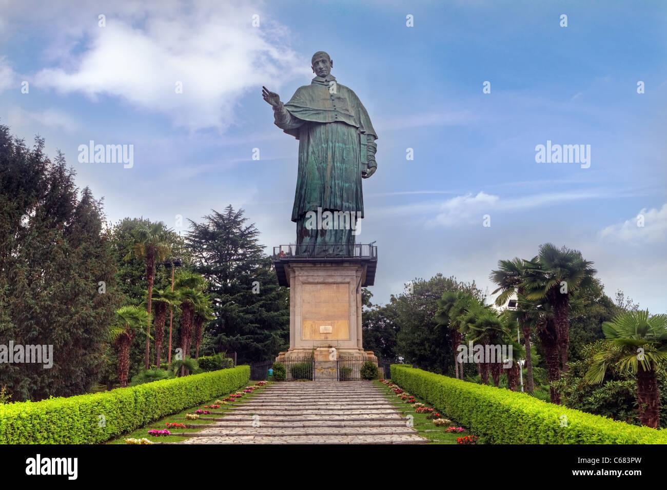 Colossal statue of Charles Borromeo in Arona, Italy - Stock Image