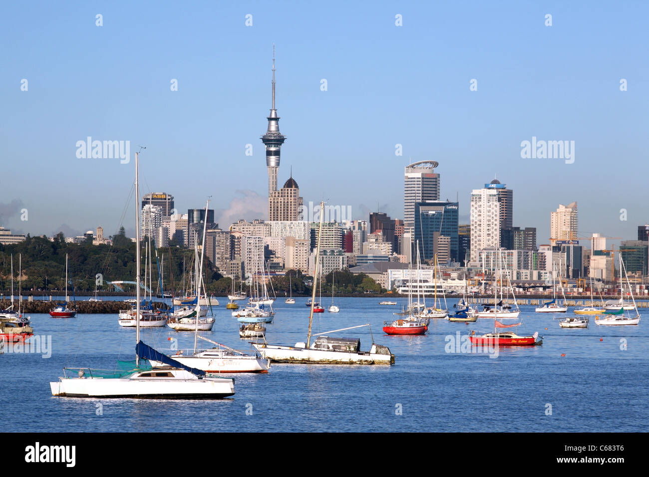 Boats moored in Okahu Bay with the city center and Sky Tower in the background. Auckland, North Island, New Zealand, - Stock Image