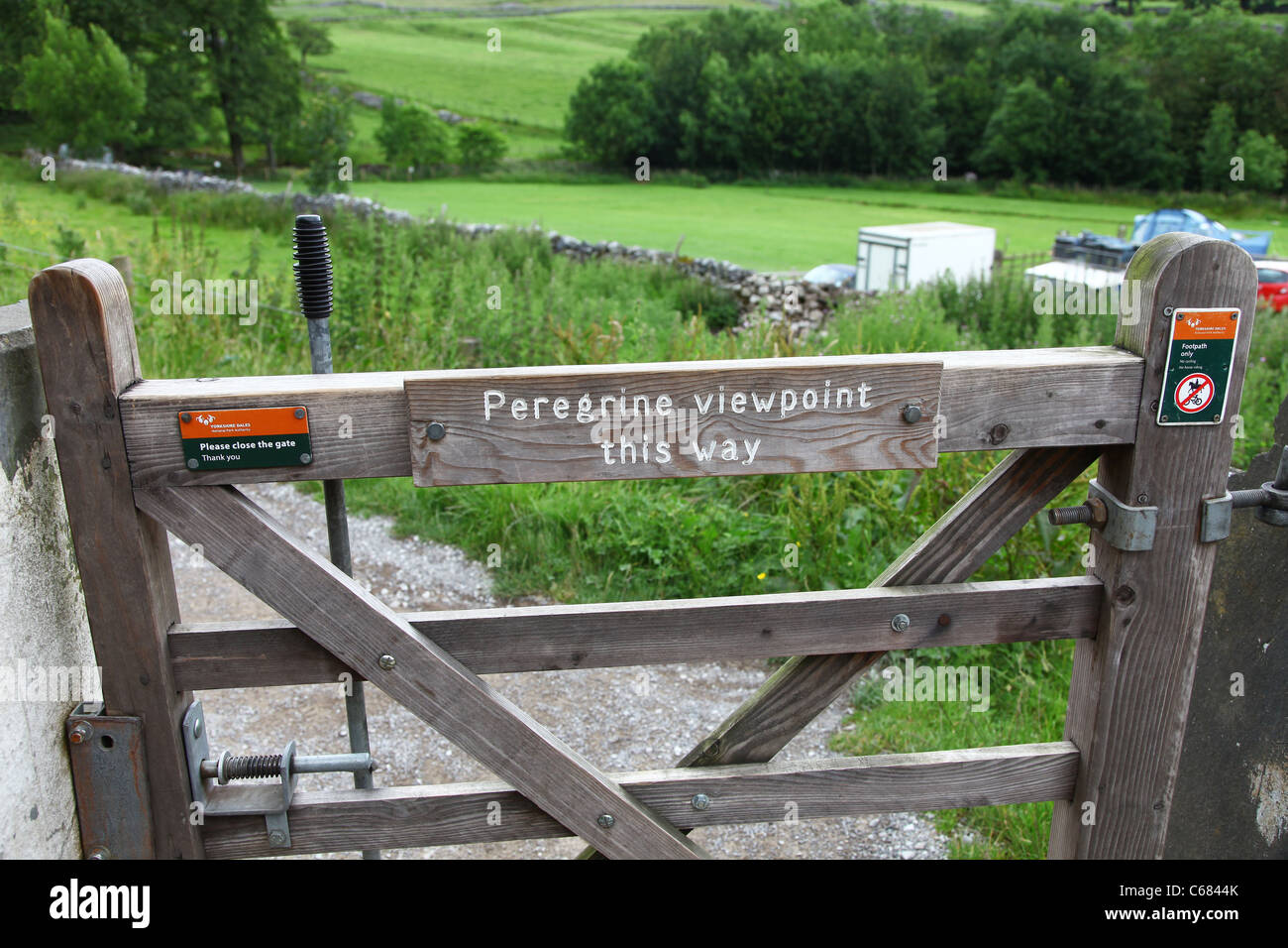 Peregrine viewpoint sign on a gate at Malham Cove, Yorkshire, Yorkshire Dales National Park, England, UK - Stock Image