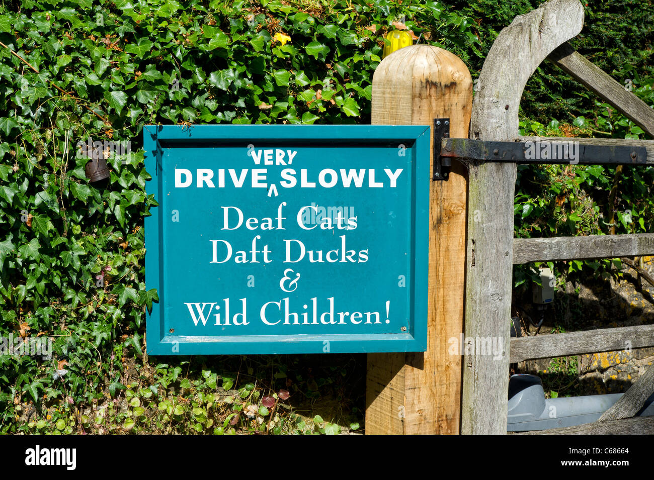 Funny Sign On The Gate Outside Mill Dene Garden In The Cotswold Village Of  Blockley