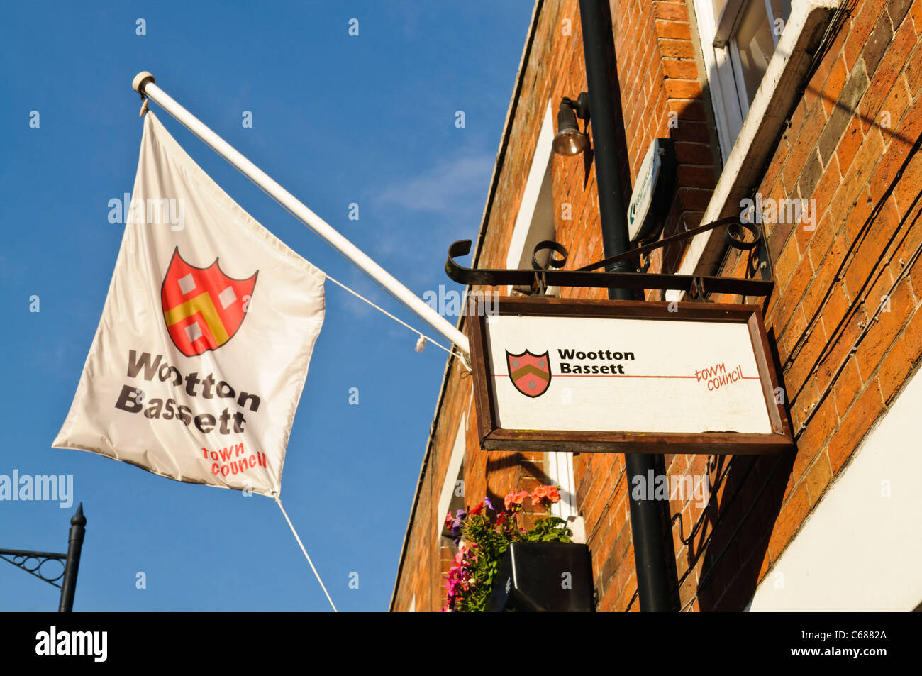 Wotton Basset Town Council flag and sign - Stock Image
