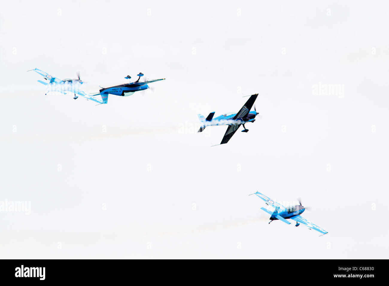 The Blades aerobatics team, flying 4 Extra EA-300 LP's, at Eastbourne Airbourne 2011, East Sussex, UK - Stock Image