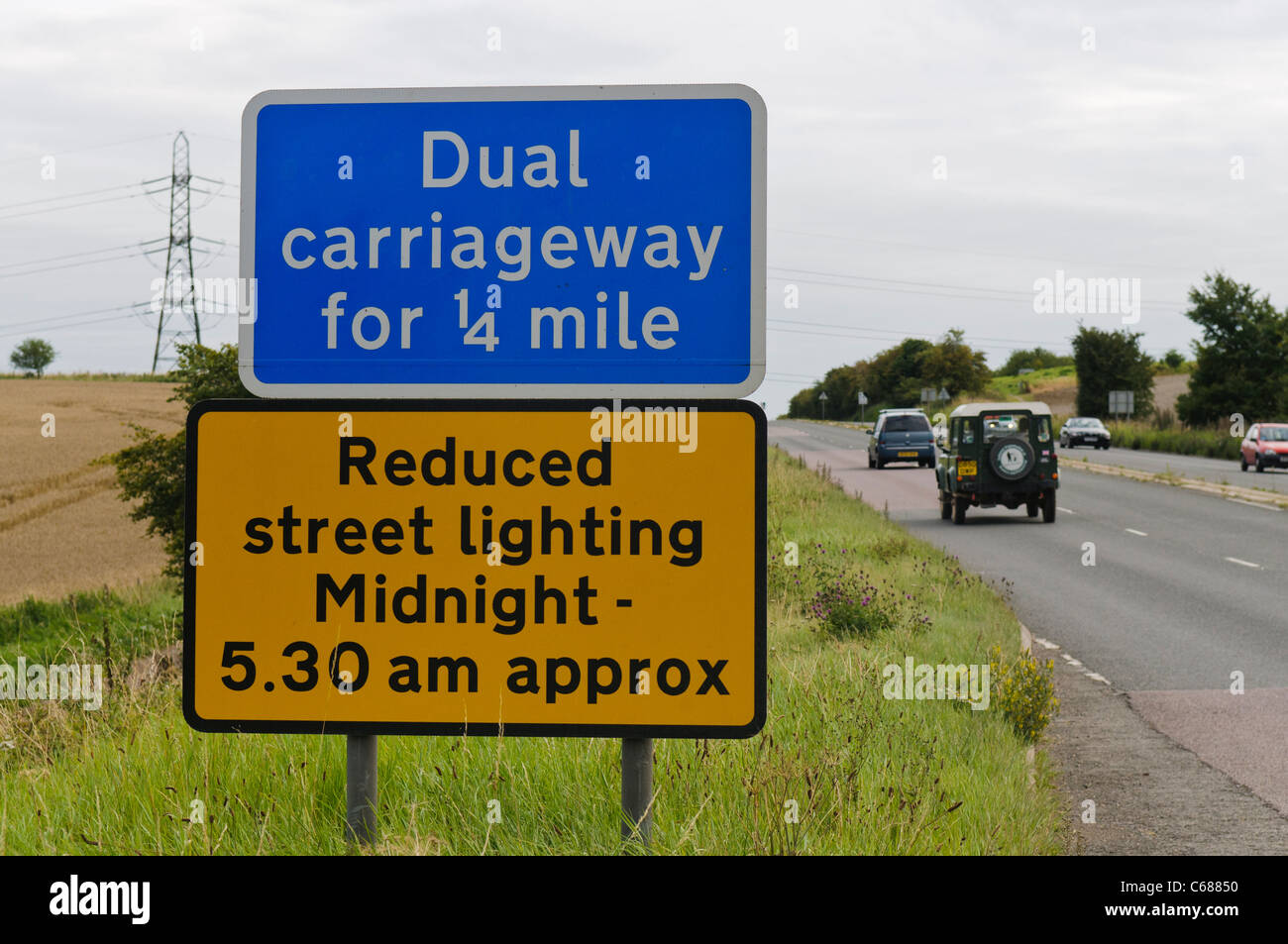 Sign at Dual Carriageway warning of reduced lighting - Stock Image