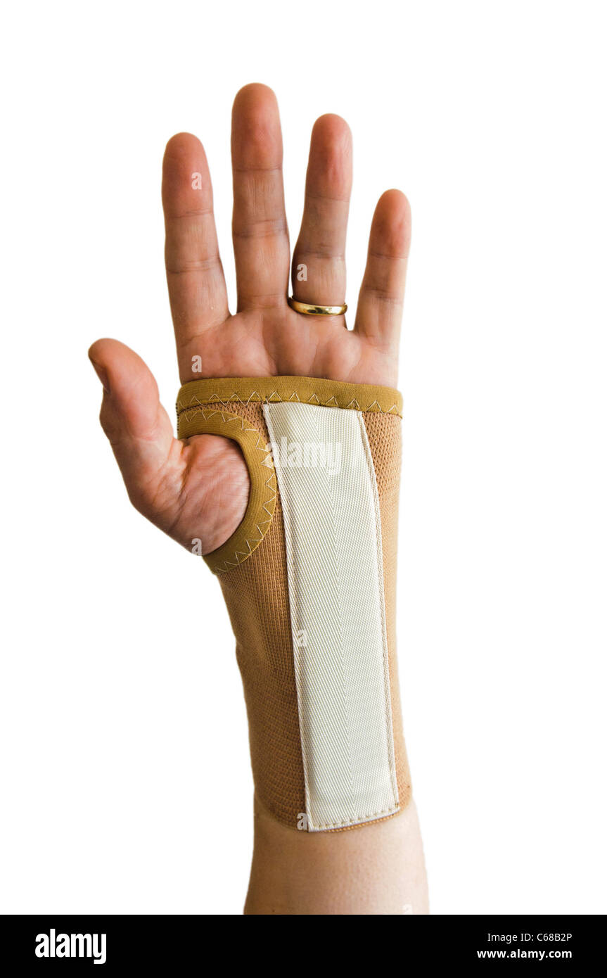 Man wearing hand splint to reduce wrist pain caused by Carpal Tunnel Syndrome - Stock Image