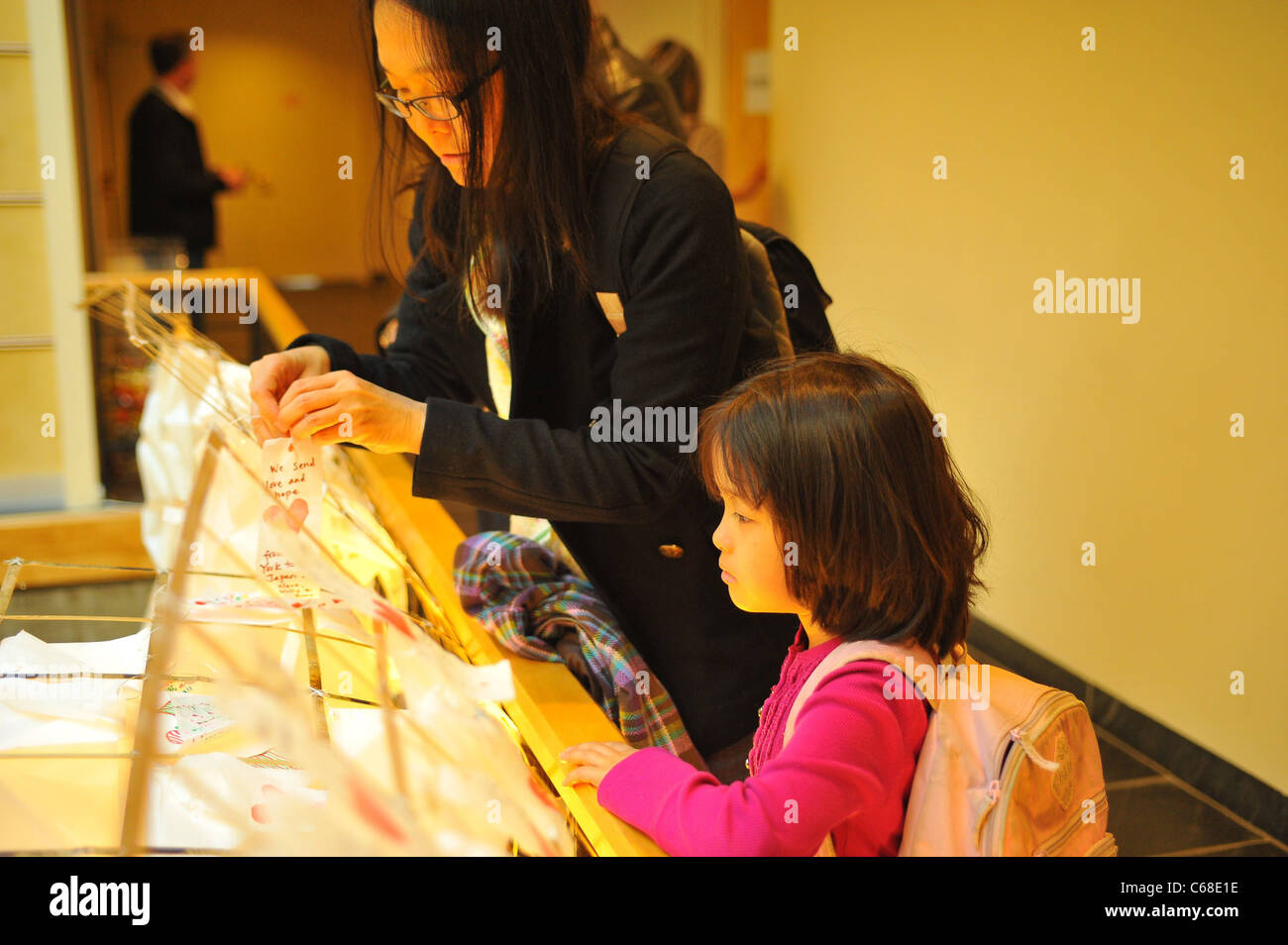 Visitors place wishes on Prayer Lanterns in attendance for Concert for Japan, The Japan Society, New York, NY April - Stock Image