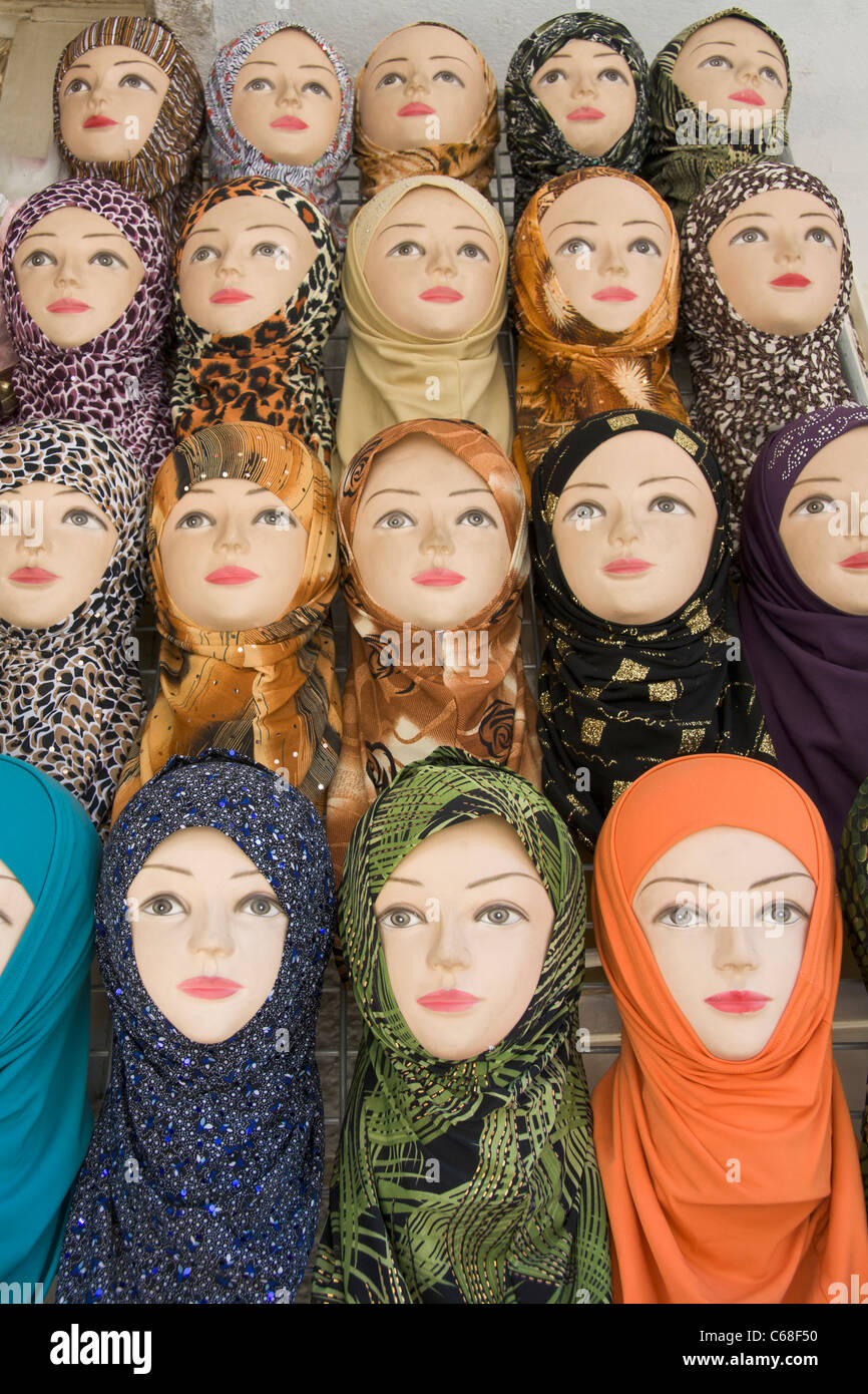 Mannequins displaying traditional Hijab headscarfs - Stock Image