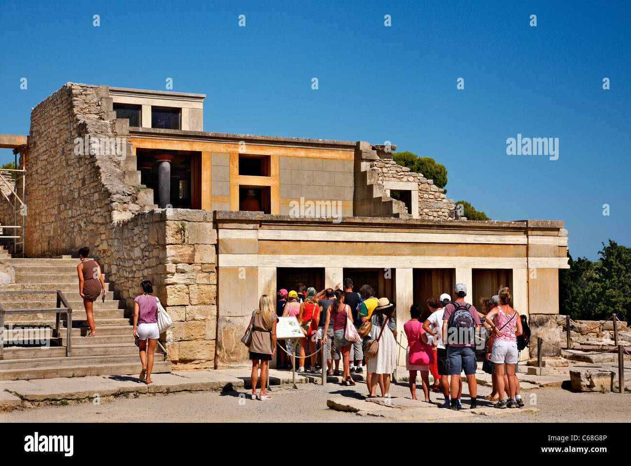 A group of tourists waiting to enter to the Hall of the Throne at the Minoan Palace of Knossos, Herakleion, Crete, - Stock Image