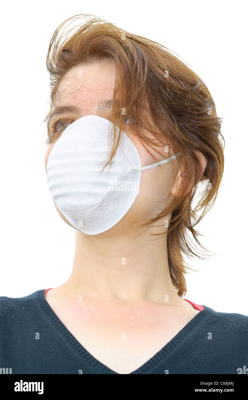 Woman wears protective mask against flu or air pollution - Stock Image
