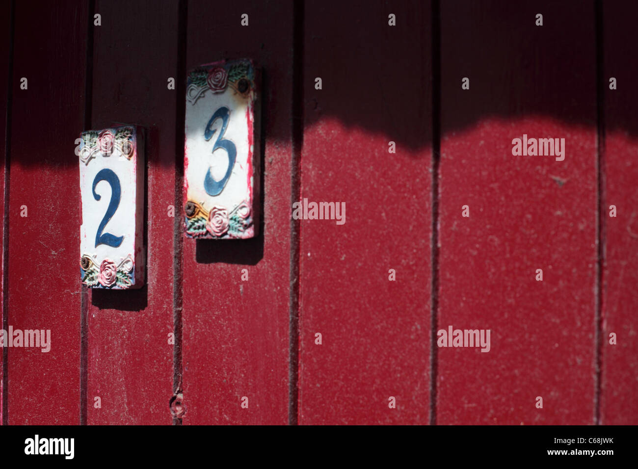 No.23 number 23 on a red door to a cottage in St Ives, Cornwall - Stock Image