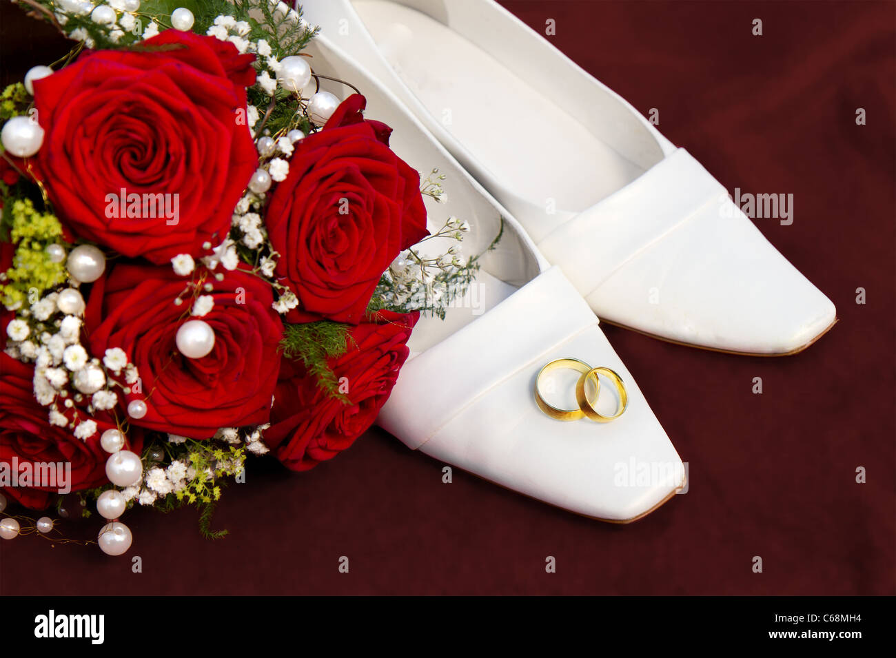 Wedding Symbol Concept With White Bridal Dancing Shoes A Red Roses