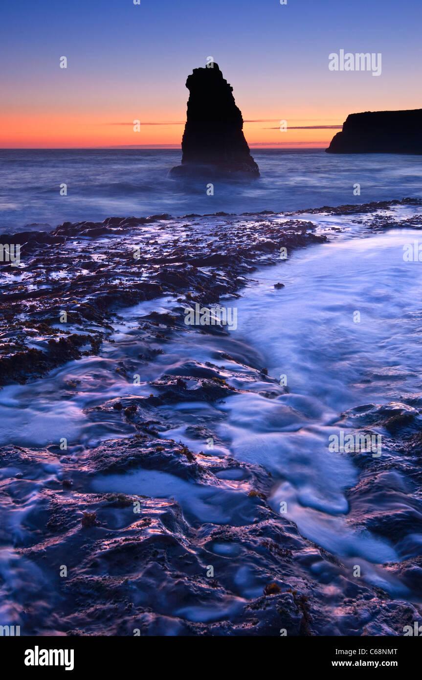 Dramatic view of a sea stack in Davenport Beach, Santa Cruz. - Stock Image