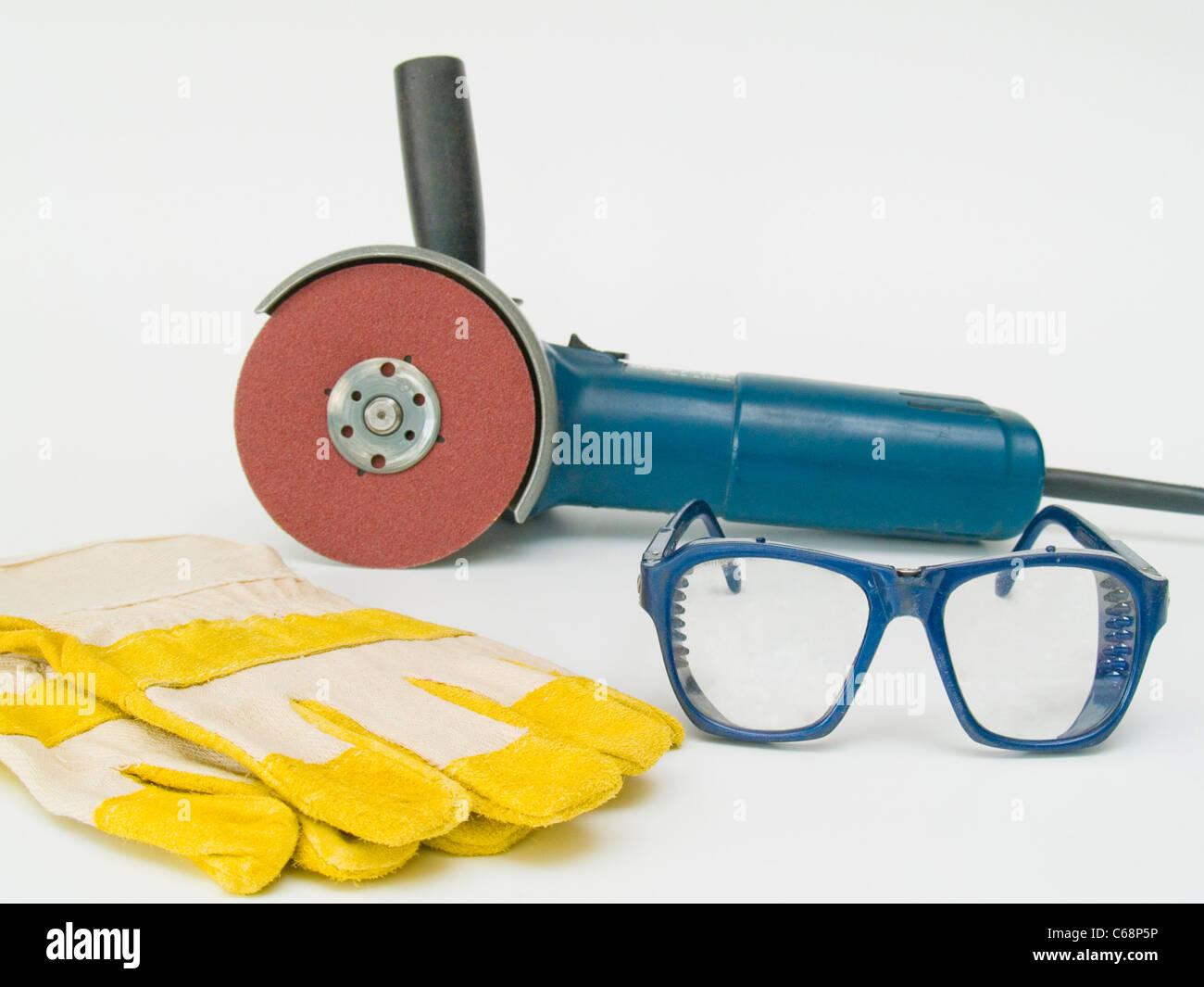 Winkelschleifer mit Schutzhandschuhen und Schutzbrille | Angle grinder with protective gloves and safety goggles Stock Photo