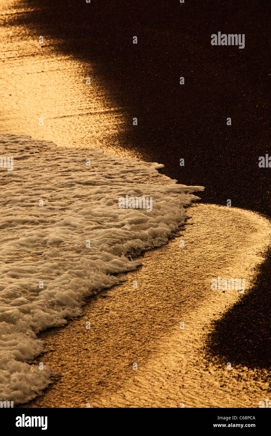 Waves breaking on beach - Stock Image