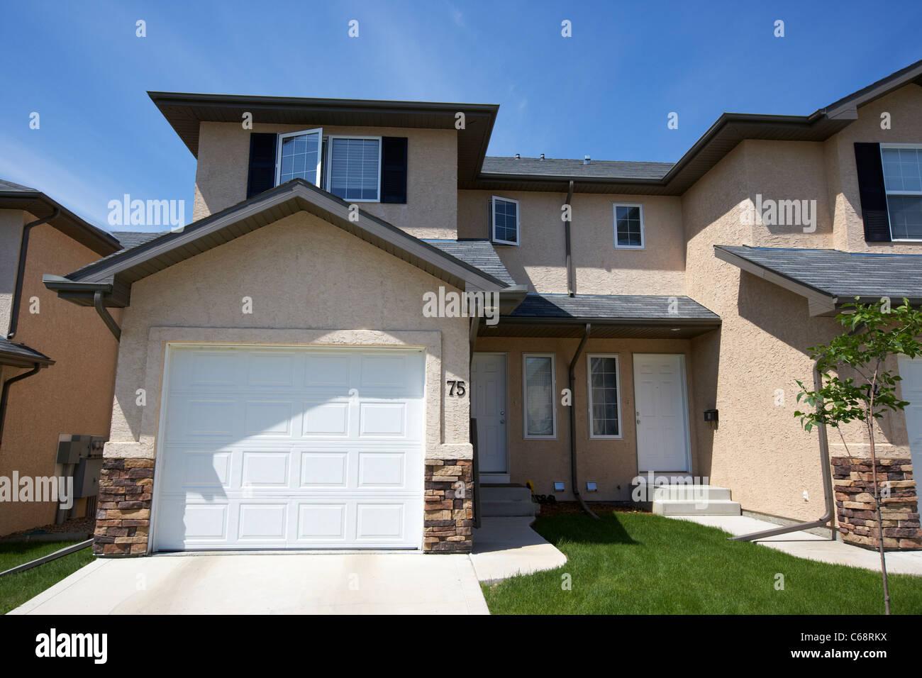 semi detached condominium property starter home on managed property Saskatoon Saskatchewan Canada - Stock Image