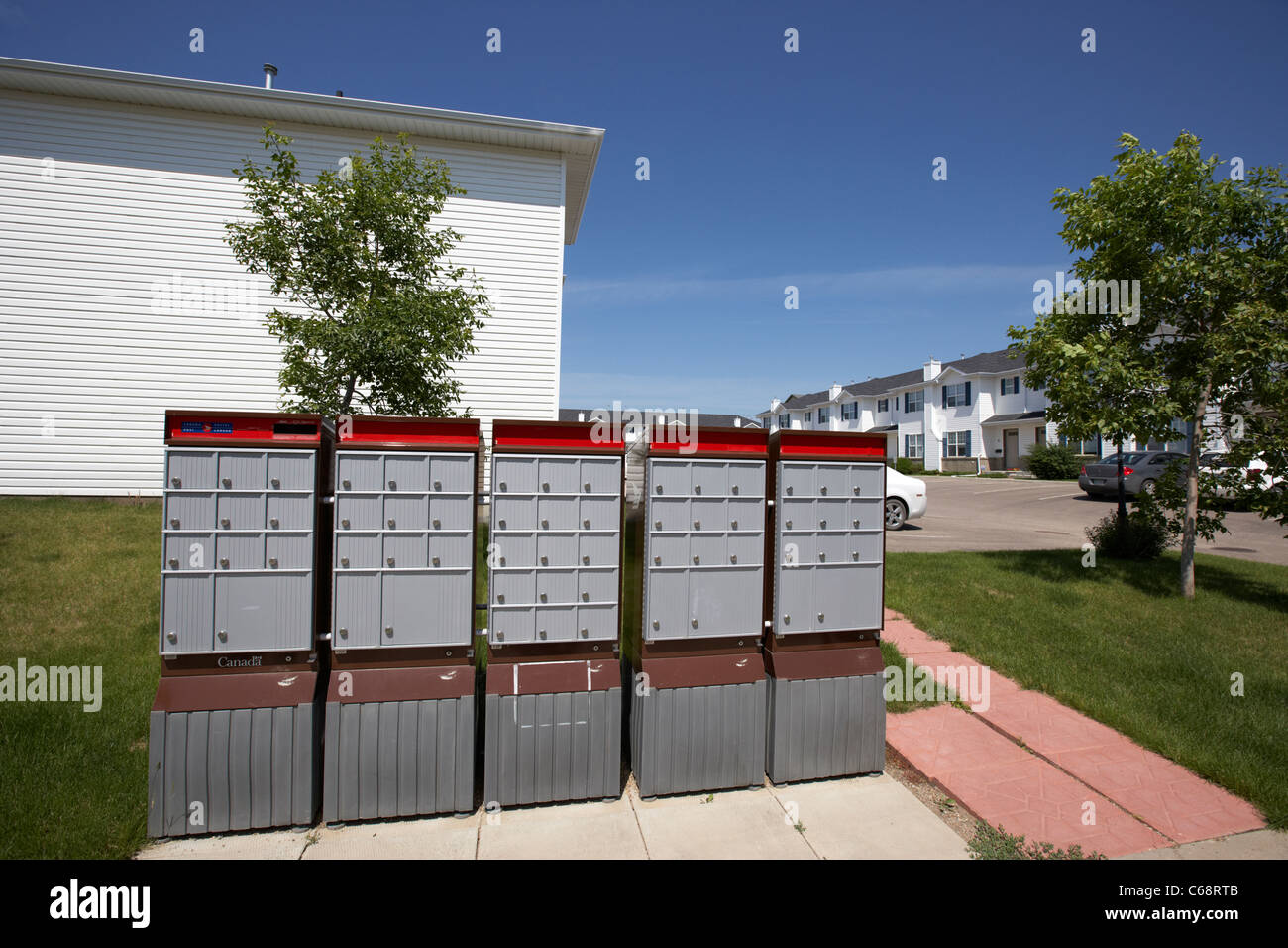 canada post residential mailboxes postboxes on condominium managed property Saskatoon Saskatchewan Canada - Stock Image