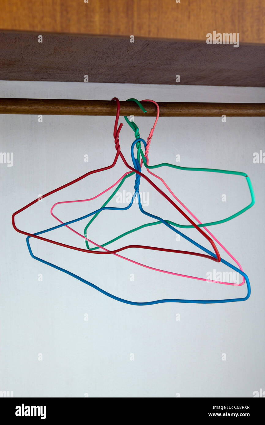 Wire Coat Hangers in Wardrobe Stock Photo: 38303071 - Alamy