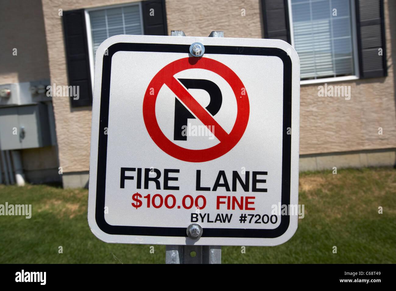 fire lane no parking fine bylaw sign in residential suburb area in Saskatoon Saskatchewan Canada - Stock Image