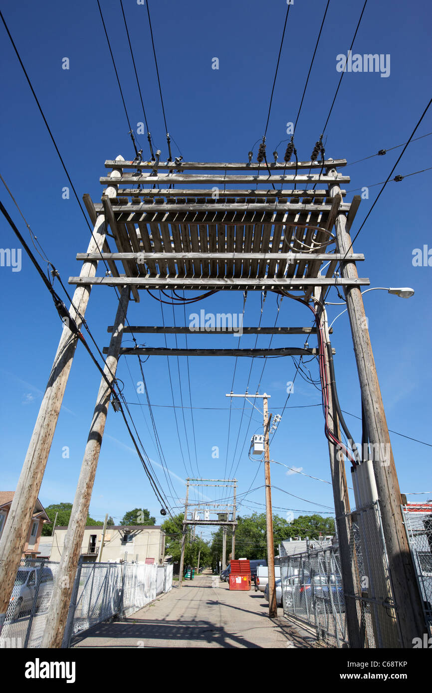 overhead power lines and town power transformer local electricity transmission Saskatoon Saskatchewan Canada - Stock Image
