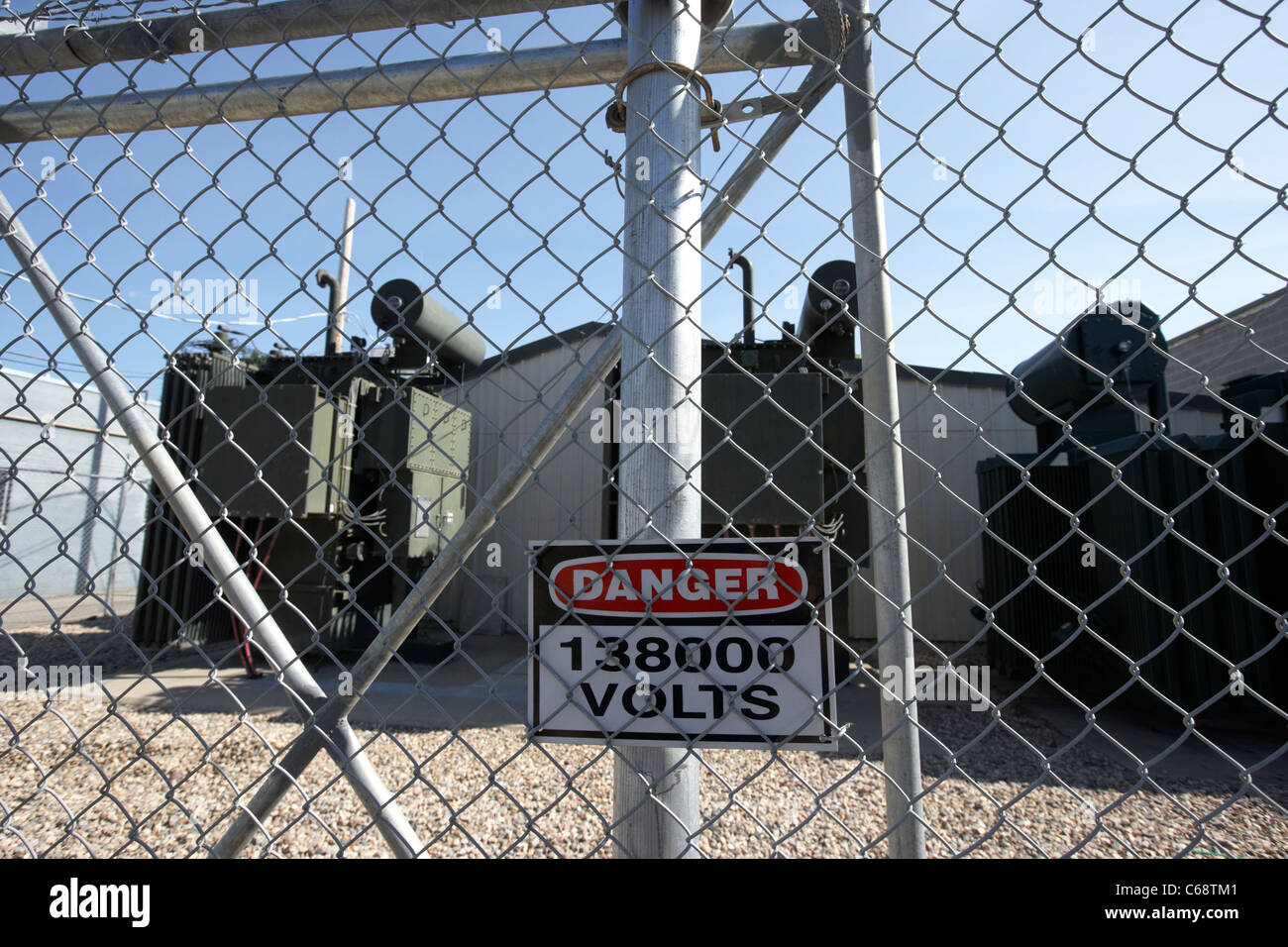 danger 138000 volts sign on town power transformer local electricity transmission Saskatoon Saskatchewan Canada - Stock Image