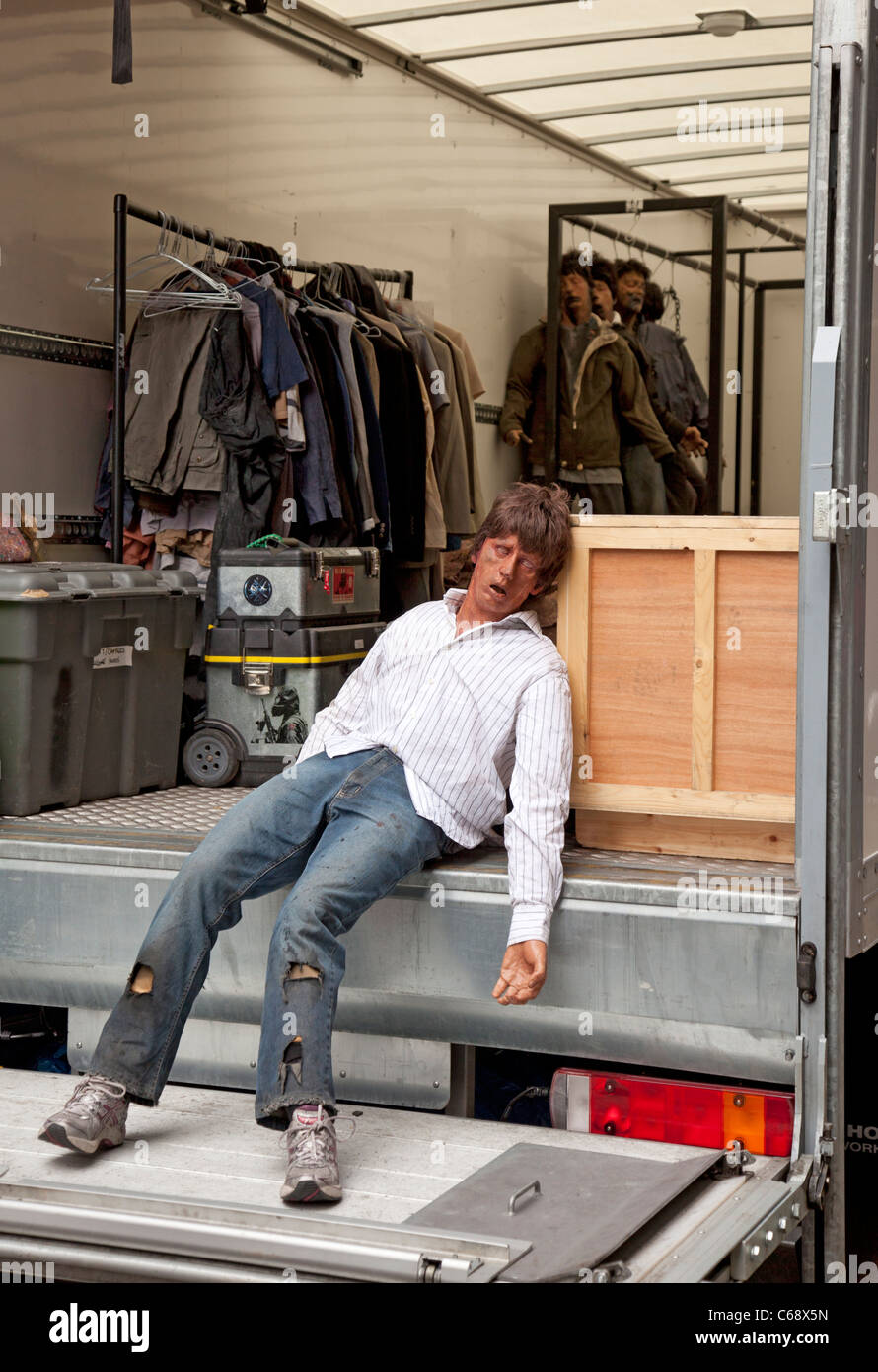 Model zombie and other props in a trailer waiting to be used in shooting the Brad Pitt movie World War Z, George - Stock Image