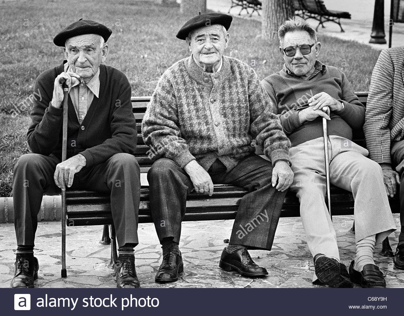 62d07ddff7ed5 Three old men - two with traditional Basque berets - sit on a park bench in  Bermeo