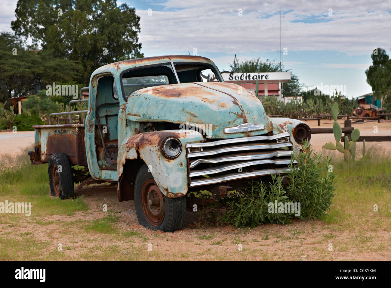 abandoned vehicle, remains of a classic car at famous filling station of Solitaire, Namibia, Africa - Stock Image