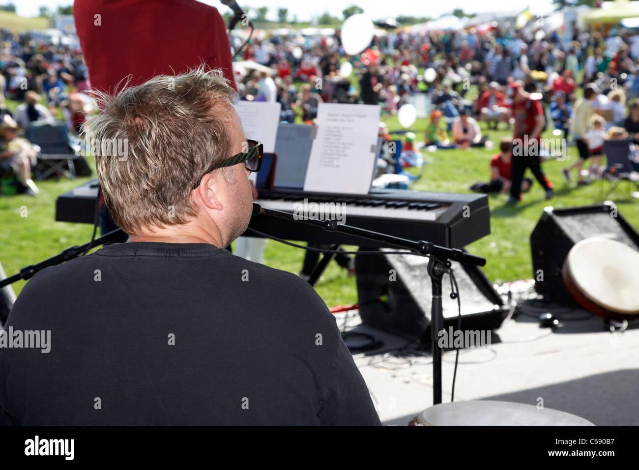 musician drummer singer on stage at a summer outdoor festival Saskatoon Saskatchewan Canada - Stock Image