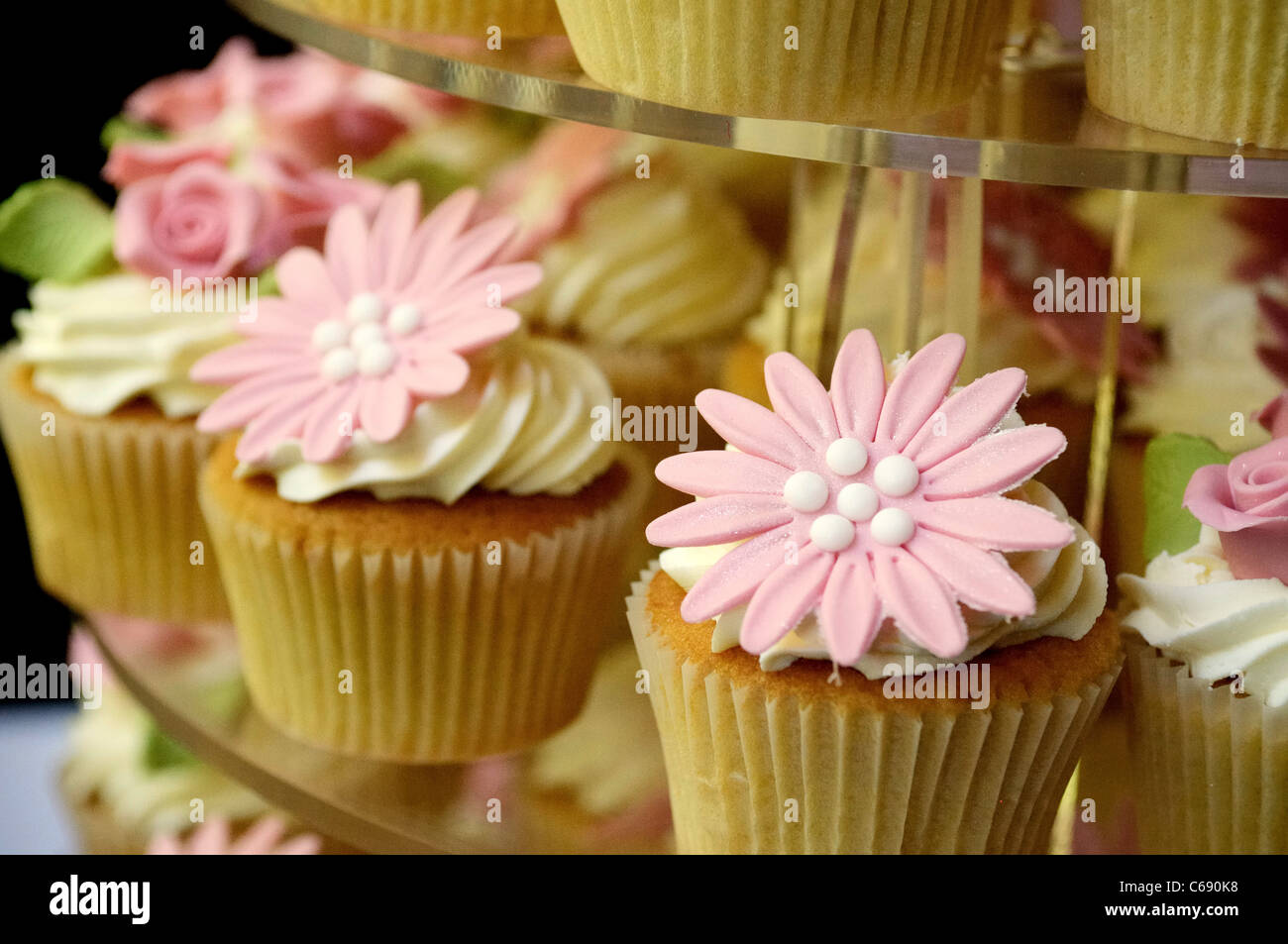 Wedding cake made from a stack of cup cakes cupcakes Stock Photo ...