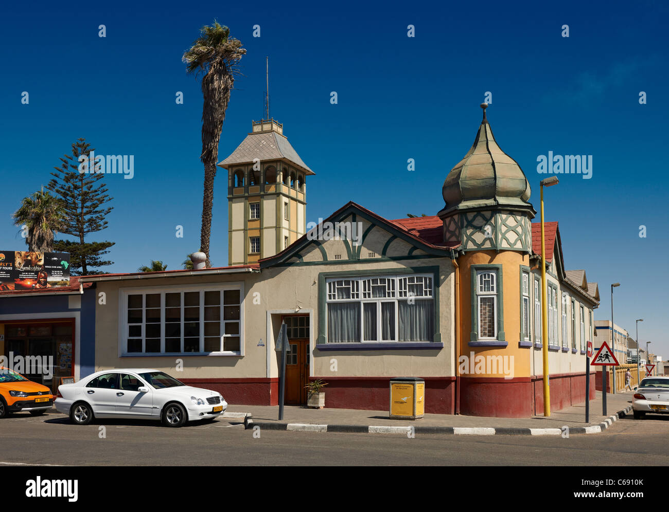 colorful historical building from German colonial period at main road, Swakopmund, Namibia, Africa - Stock Image