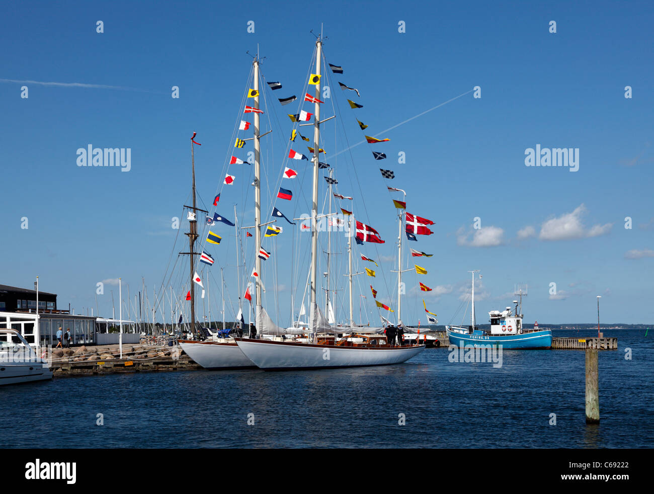 The two training ships Svanen (The Swan) and Thyra of the Danish Navy on the traditional visit to Rungsted Harbour - Stock Image
