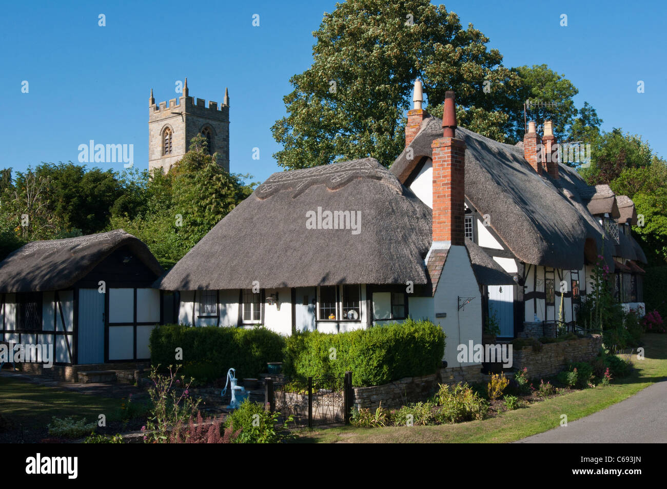 Tenpenny cottage and village church in Welford on Avon Warwickshire. UK - Stock Image