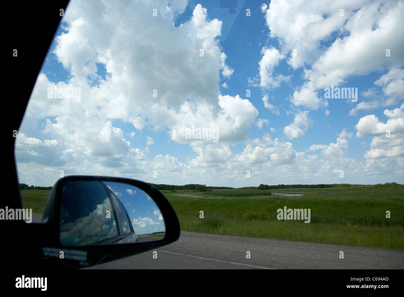 looking out window at cloudy sky on yellowhead highway route 16 through Manitoba Canada - Stock Image